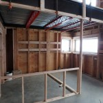 Kitchen with red trusses
